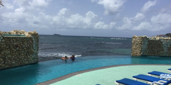 The pool view goes off to infinity at the Oyster Bay Beach Resort.